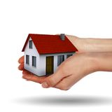 Little House on the hands. And the girls. symbol of a successful real estate business Stock Image
