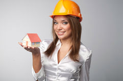 Little House in the hands. Of young and beautiful business woman Royalty Free Stock Photography