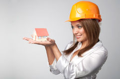 Little House in the hands. Of young and beautiful business woman Stock Photo