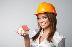 Little House in the hands. Of young and beautiful business woman Royalty Free Stock Image