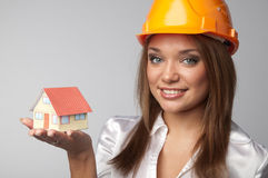 Little House in the hands. Of young and beautiful business woman Royalty Free Stock Images