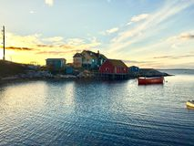 Little house on the harbour. Tiny fishing village hidden on oceans edge in the east coast of Canada stock image