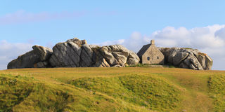 The little house inside the rocks Royalty Free Stock Image