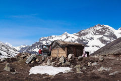 Little House And Jeep Snow Mountain Royalty Free Stock Photography
