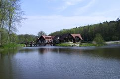 Little house on the lake. Small home at the lake in the polish wood Royalty Free Stock Photo