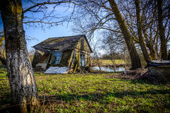 Little house by little lake Royalty Free Stock Image