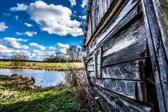 Little house by little lake Royalty Free Stock Photo