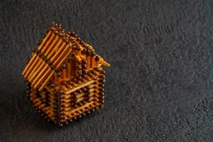 Little house model of matches on a dark background stock images