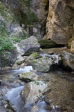 Little house in the mountain stream Stock Photography