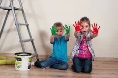 Little house-painters with dirty hands Stock Photos