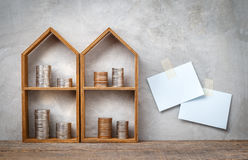 Little house shelf and coins. Royalty Free Stock Photography