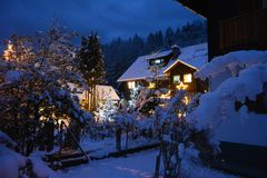 A little house in the snow, covered with Christmas lights royalty free stock image
