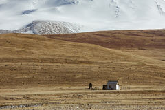 Little house on the snow mountains background Royalty Free Stock Photography