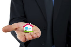 Little house symbol in hand Stock Photos