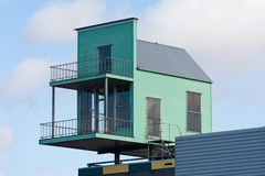Little house at the top of a bigger building Royalty Free Stock Photos