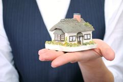 Little house in womans hand Stock Image