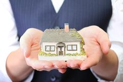 Little house in womans hands Stock Photography