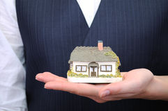 Little house in womans hands Royalty Free Stock Images