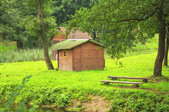 A little house in the woods. A little house in the forest landscape Stock Photo