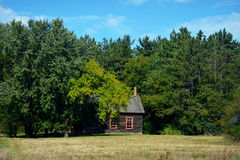 Little House in Woods Stock Images