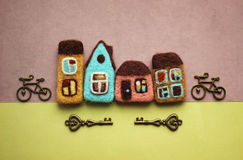Little Houses, bicycles and keys. Houses and decorative little bicycles Royalty Free Stock Photo