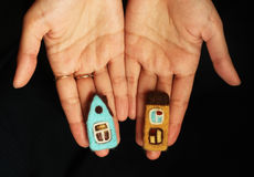 Little houses in female hands stock photography