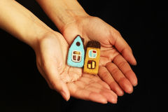 Little houses in hands Royalty Free Stock Photo