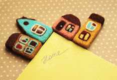 Little houses. And inscription home Royalty Free Stock Image