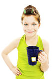 Little housewife with cup of tea. Isolated on white background Royalty Free Stock Photos