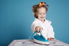 Little housewife with iron Royalty Free Stock Images