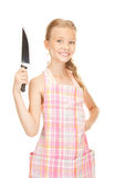 Little housewife with knife. Picture of little housewife with big knife stock photos