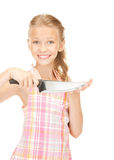 Little housewife with knife Stock Photo