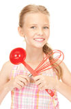 Little housewife with red ladle Royalty Free Stock Photos