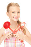 Little housewife with red ladle Royalty Free Stock Photography