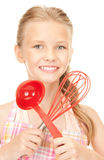 Little housewife with red ladle Royalty Free Stock Images
