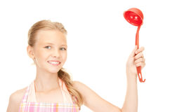 Little housewife with red ladle Royalty Free Stock Photo