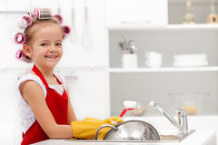 Little houskeeping girl Stock Image