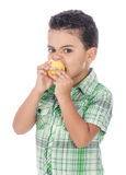 Little Hungry Boy Eating Fruit royalty free stock image