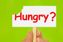 Little Hungry Sign on Green Background Royalty Free Stock Photography