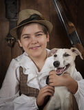Little hunter with a dog Stock Images