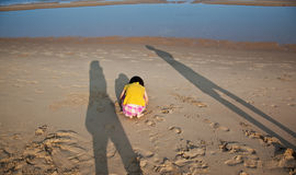 Little hurt child and parents shade on the beach Royalty Free Stock Photography