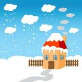 Little hus i snowen Arkivbild