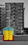 Little Hut. Little colourful beach hut on Brighton and Hove promenade with black and white high rise building contrasting in the background Stock Image