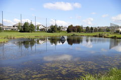 Little hut on pond in golf course Stock Images