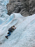 A little ice climber. Boy on a ice wall. Briksdal glacier, Norway Stock Photo