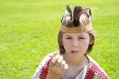Little indian boy with peace-pipe Royalty Free Stock Photo