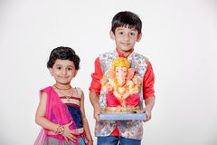 Little Indian children with lord ganesha and praying , Indian ganesh festival royalty free stock photos