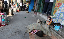 A little Indian girl sleeping on the street, Kolkata Royalty Free Stock Image
