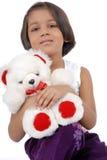 Little Indian girl with teddy bear Royalty Free Stock Photos