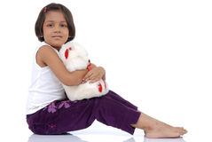 Little Indian girl with teddy bear Stock Photo